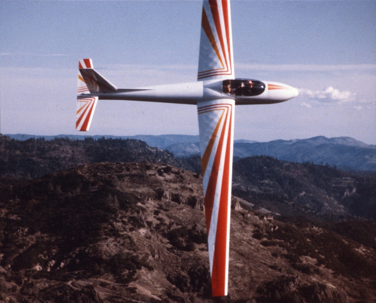 Photo shows shell buckling glider wings while glider makes hard banked turn